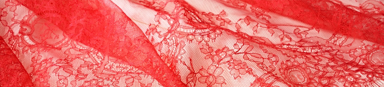 red lace fabrics at TISSURA fabric shop